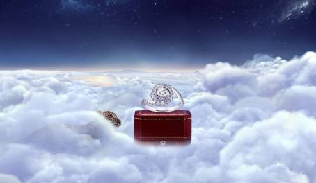 """In Cartier's""""Winter Tale"""" ad series, kittens who live in the sky (leopards? panthers? I don't know, I get the wild cats all mixed up) sneak up ongift-wrappedjewelryitems. It's cute because the cats are babies, but it's sad because if they're in the clouds, I guess they're dead? So, dead baby cats. But lots of diamonds. The point is, ladies, if you'rea majestic angel-kitten, heavenly trinkets are yours for the stalking. So be a wild, sexy, dead, luxurious cat-baby."""