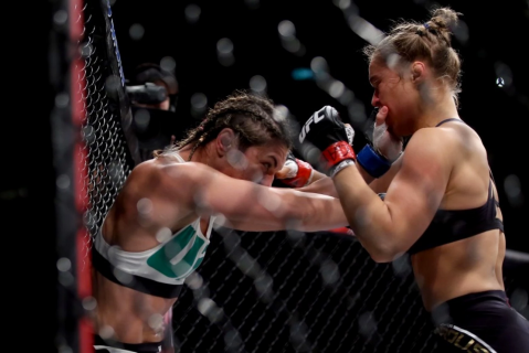Just some ladies fighting in a cage, you know how it is.  (Photo via The Washington Post - Matthew Stockman / Getty Images)